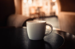 closeup of a cup of coffee at coffee shop