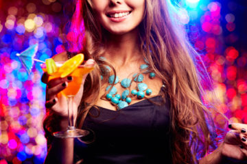Image of happy girl with cocktail in the night club